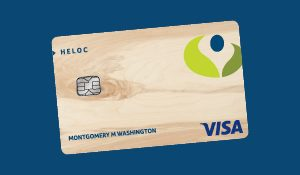 Numerica woodgrain HELOC Visa card on a blue background