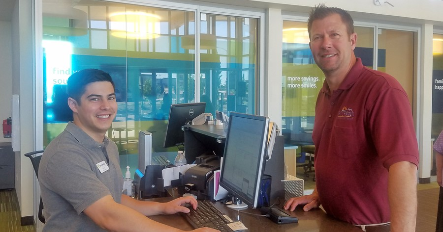 Numerica Credit Union Gage branch employee Jimmy Rutkowsky helps a member