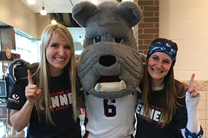 2 Numerica Employees posing with Spike the Gonzaga Bulldog