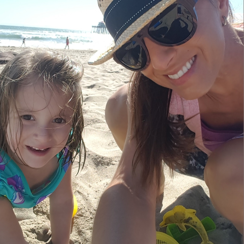 Mother on beach with daughter