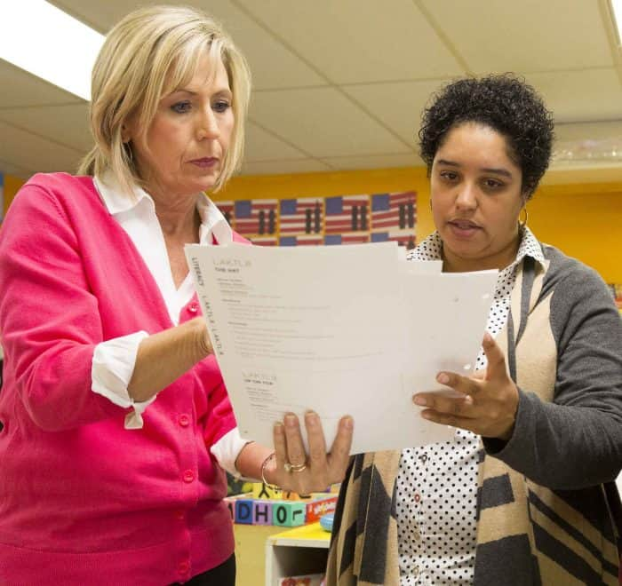 Waterford professional development team member helps teacher look at reports.