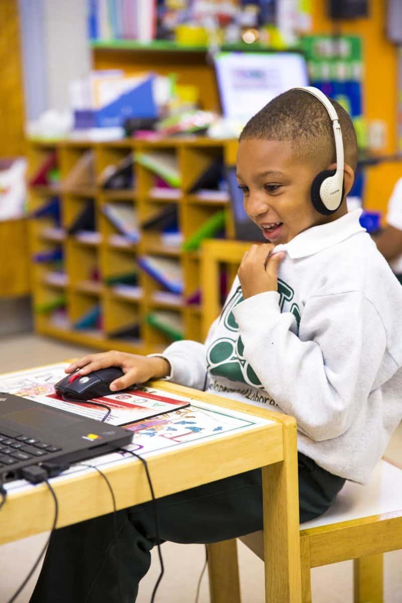 boy using Waterford on desktop computer