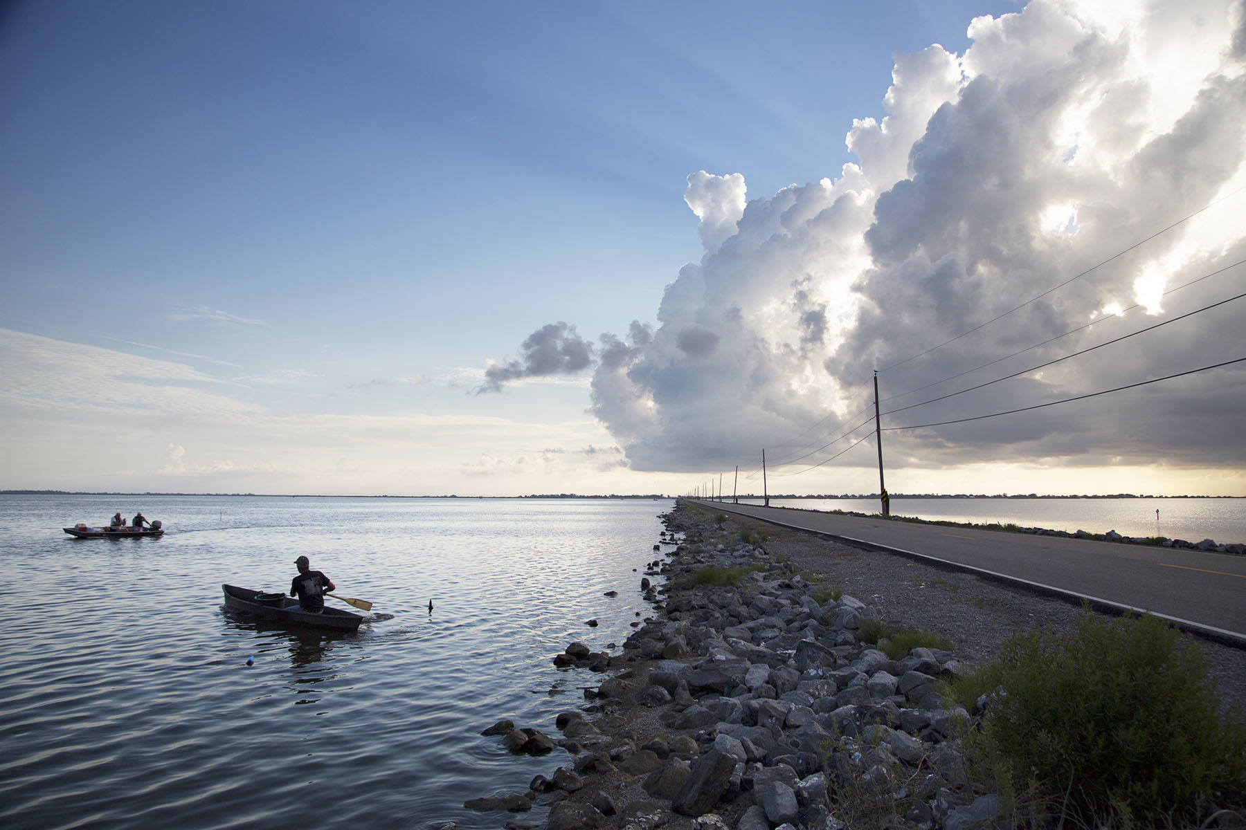 Craig Dufrene of Thibodaux paddles his boat off of Island Road where he spent the morning trapping crabs in July, 2014.