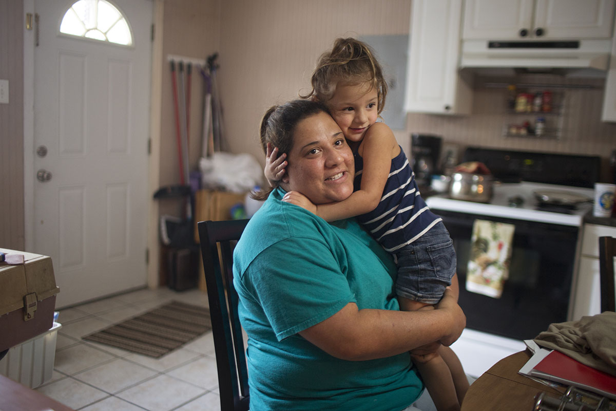Valerie Viguerie and her daughter Amya, 3, visit Valerie's parent's home.