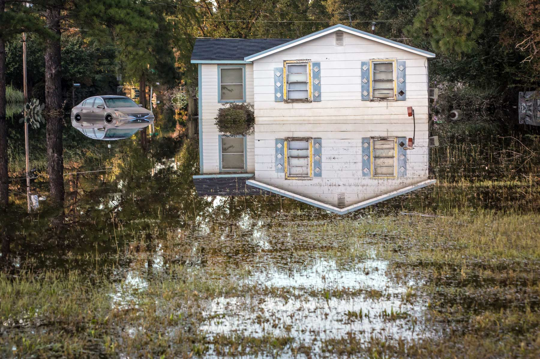 A home and its surroundings are clearly reflected through the high floodwaters in North Carolina. (Julie Dermansky)