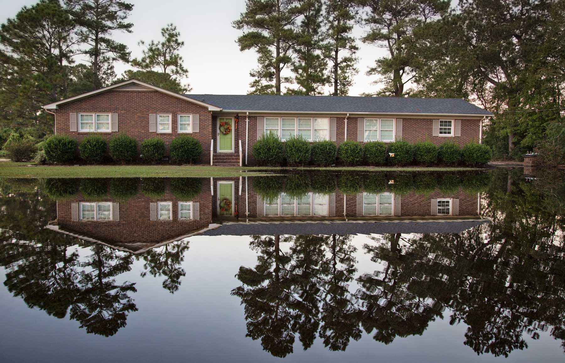 A home in Kinston, N.C. becomes fully visible as water levels recede. (Julie Dermansky)