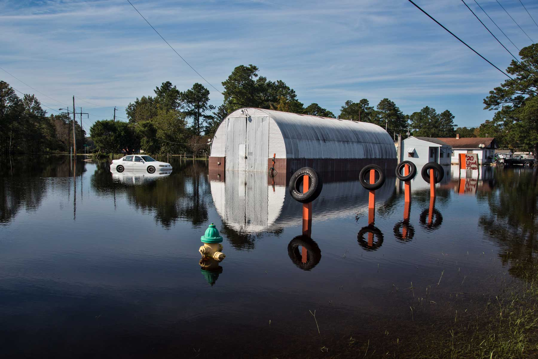 A flooded shed area in Lumberton, N.C. is reflected in the floodwater. (Julie Dermansky)