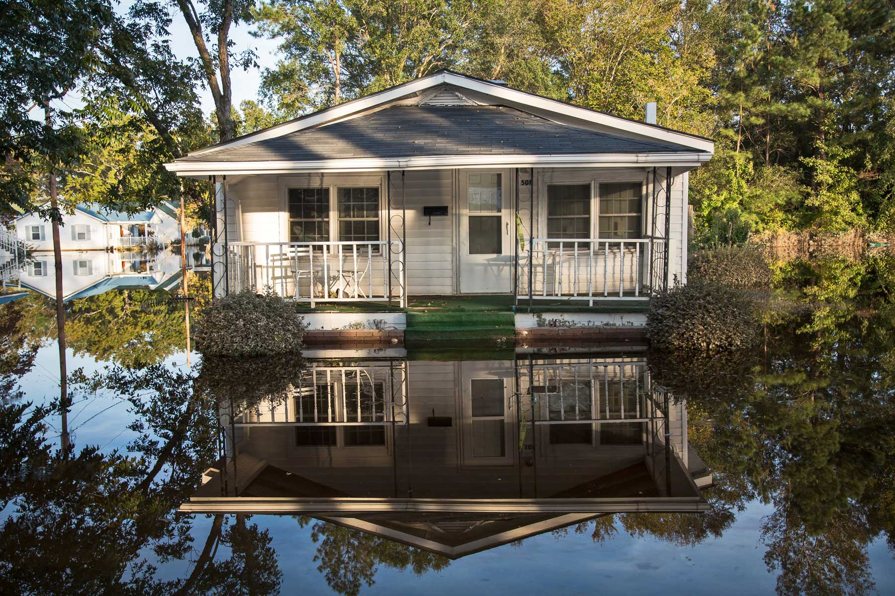 Still waters became the canvas for the photographer, capturing striking symmetry between the homes and their reflections. (Julie Dermansky)