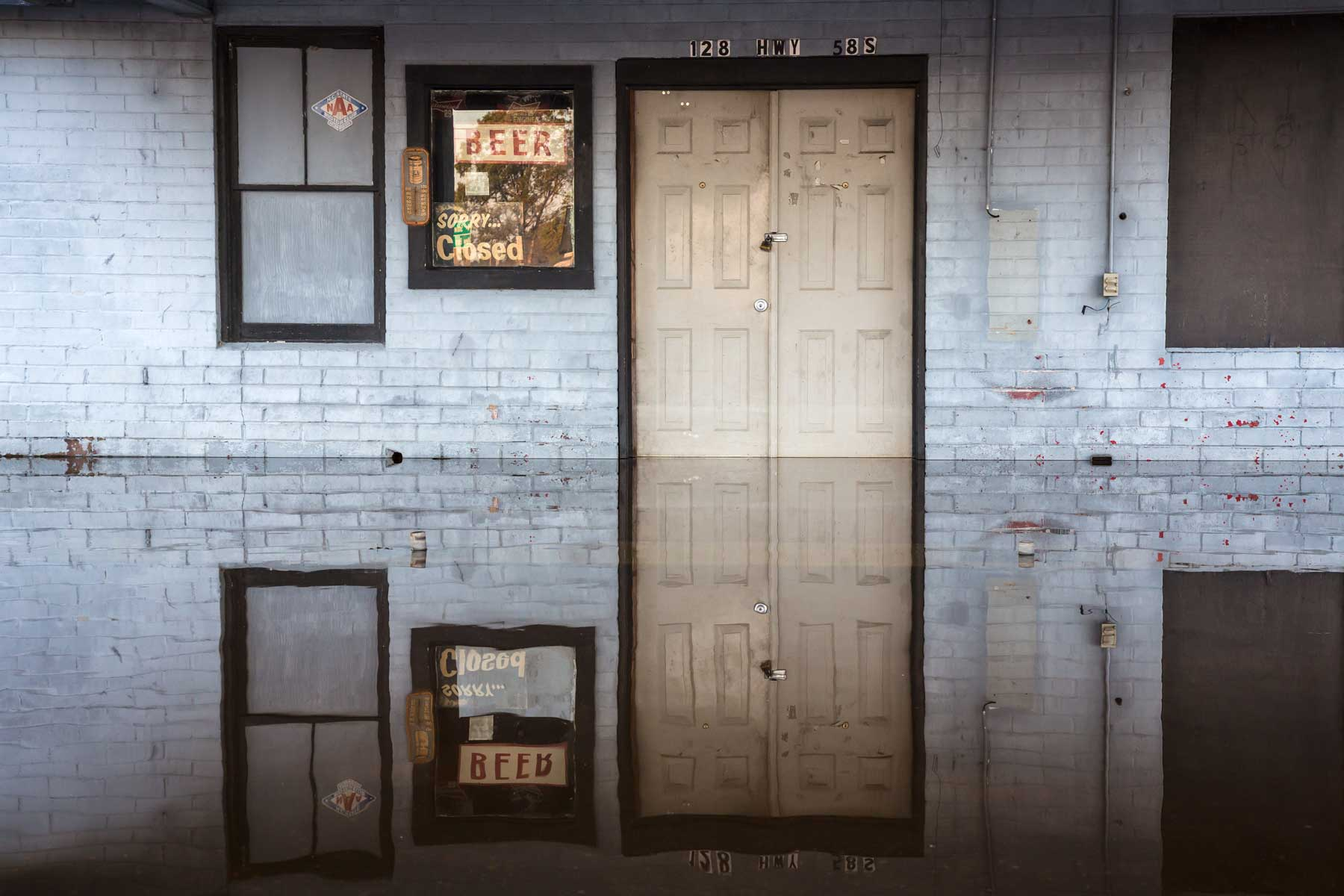 Floodwaters mirror a bar in Kinston, N.C.. (Julie Dermansky)