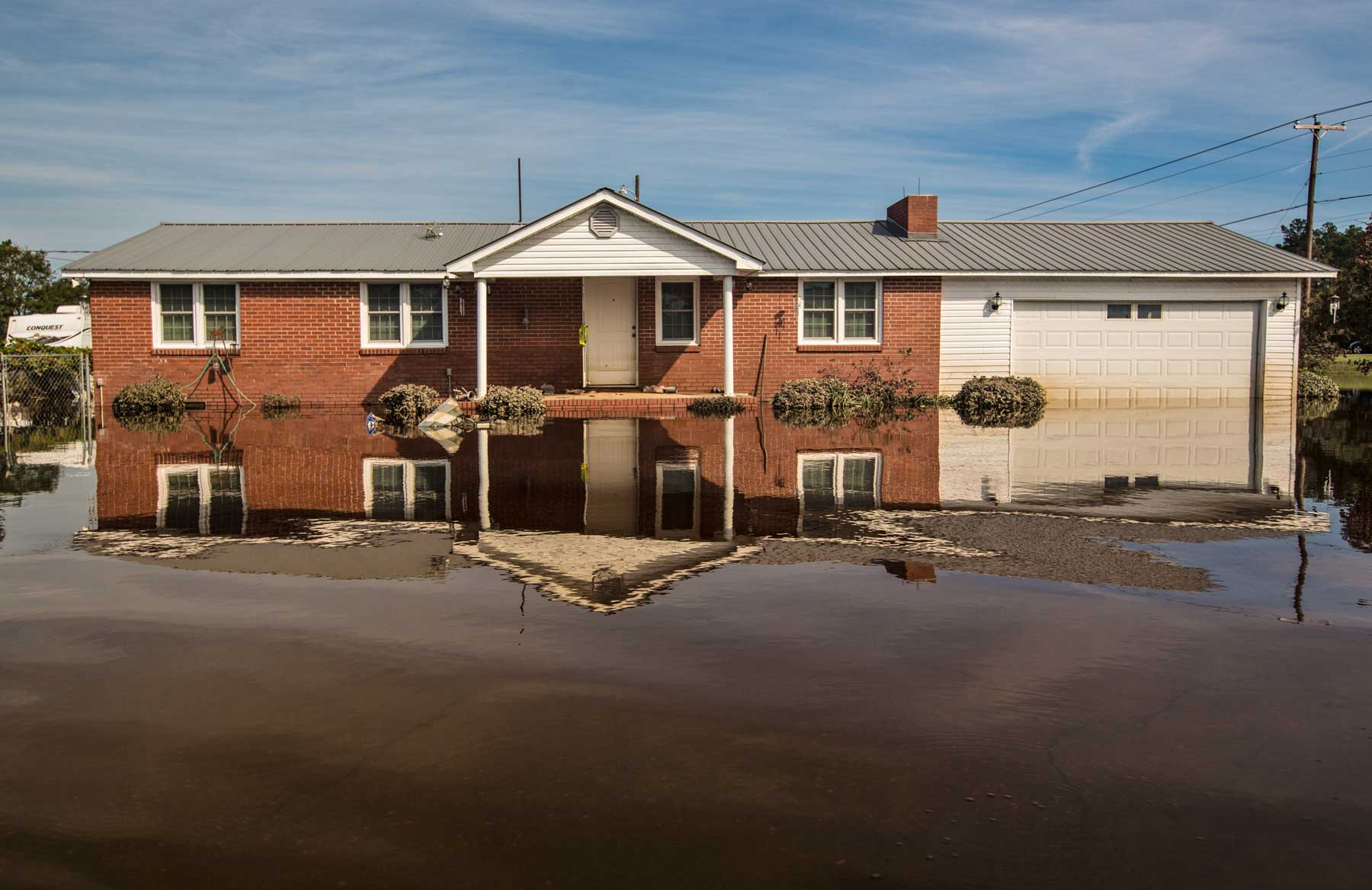 Floodwaters reflect a home in Lumberton, N.C. (Julie Dermanksy)