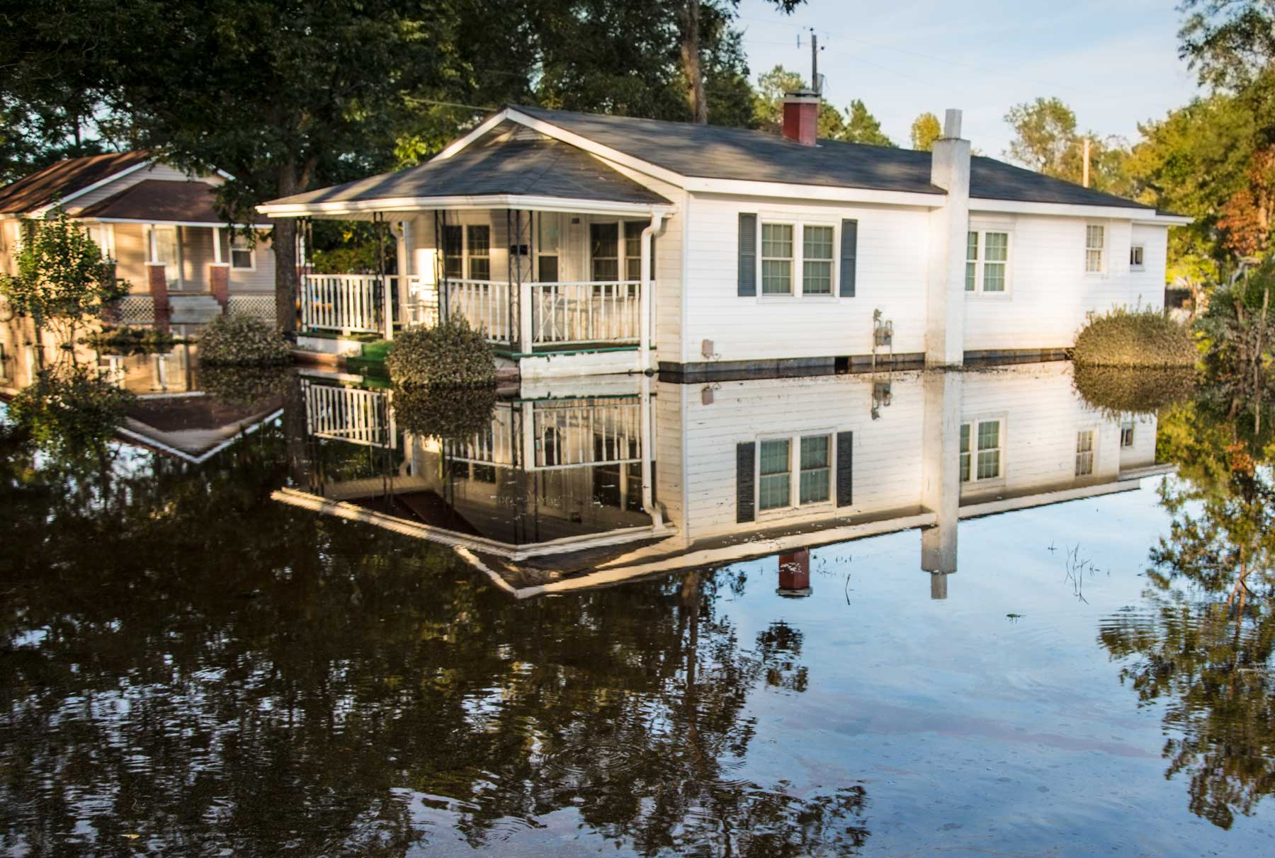 A home's property is completely inundated under floodwater. (Julie Dermansky)