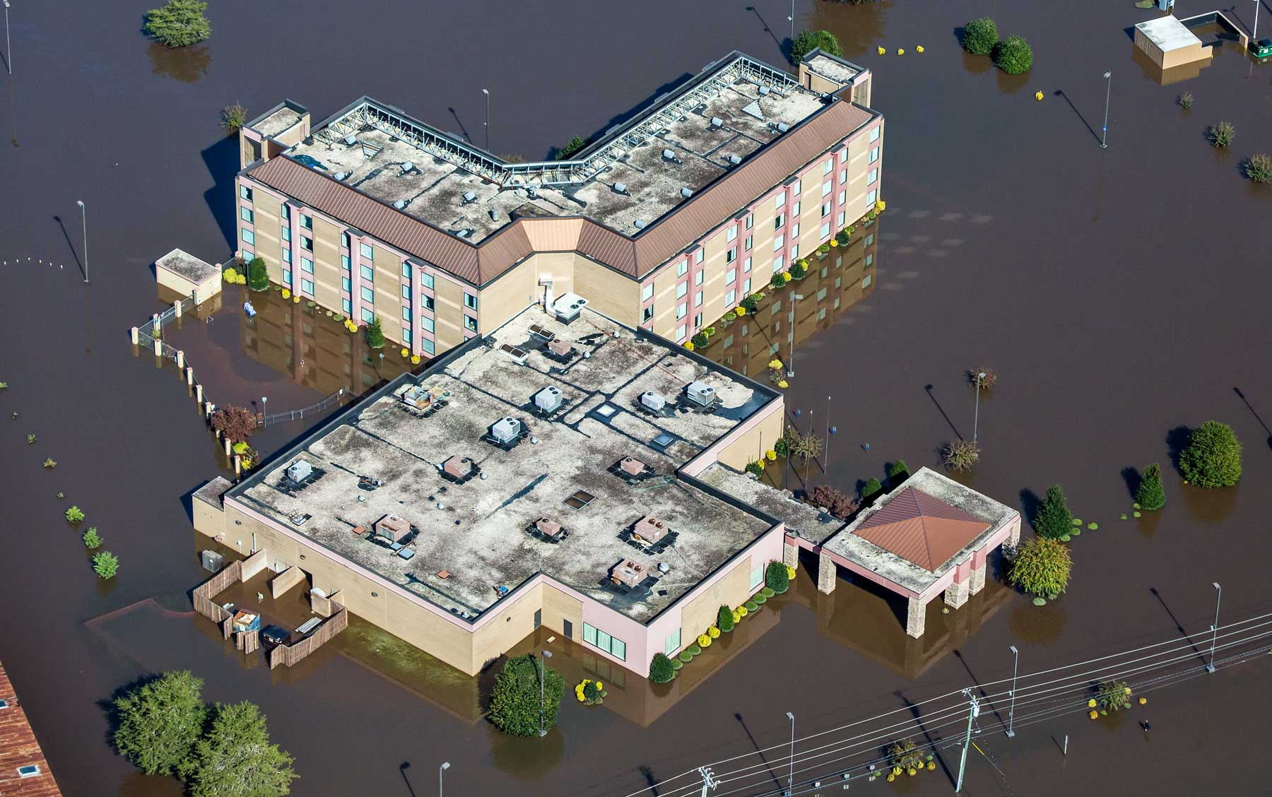 An aerial view of a flooded hotel in Kinston, N.C. (Julie Dermansky)
