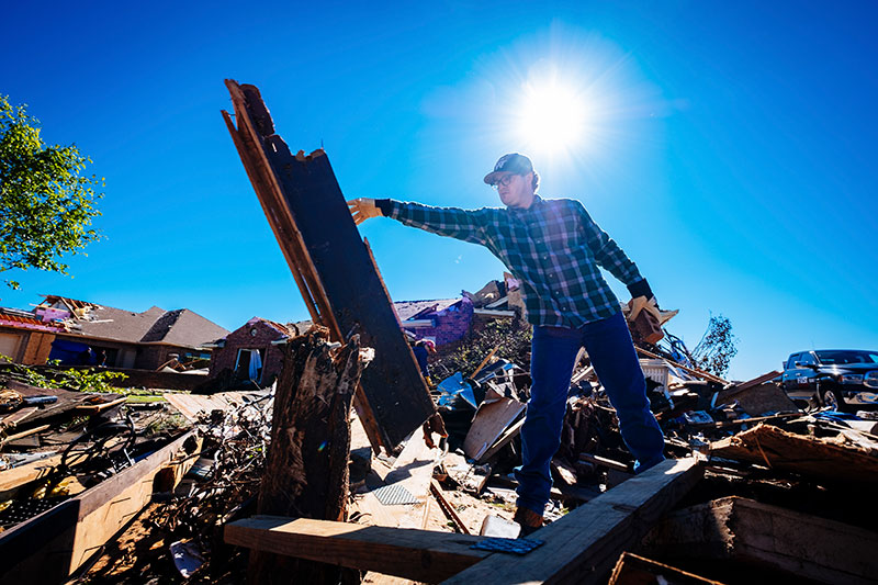 PJ Lewallen clears debris after the storm on May 20, 2017 in Elk City, Oklahoma.