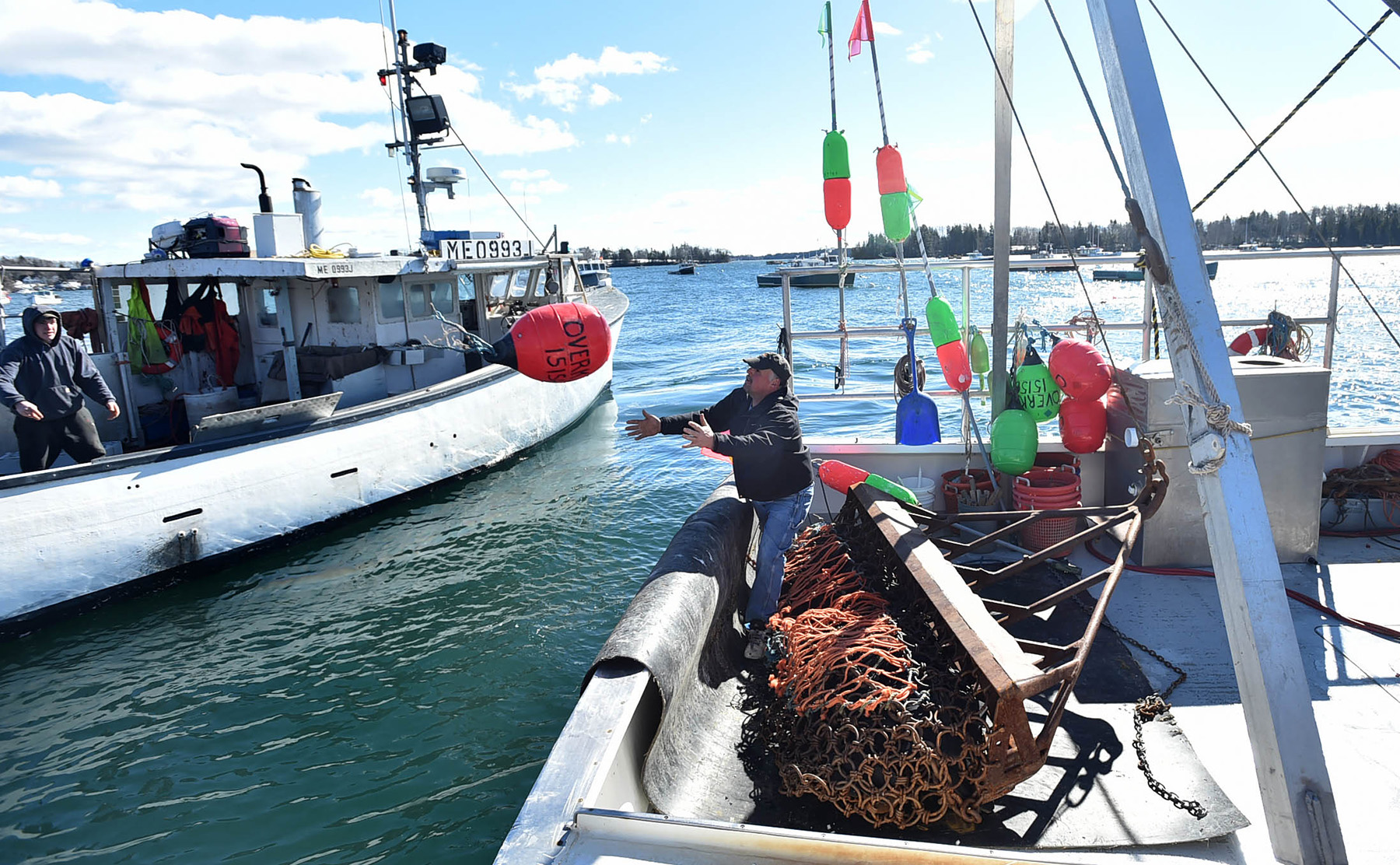 Jimmy Wotton catches a recovered buoy