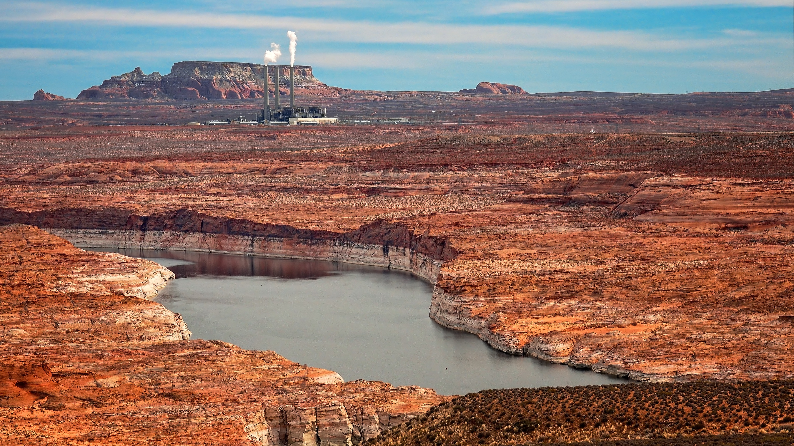 A view of Lake Powell with the Navajo Generating Station in the distance