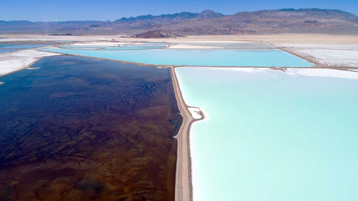 Between Reno and Las Vegas, the Silver Peaks Mine is a barren landscape rich in a substance electric vehicles rely on: lithium. The only operating lithium mine in North America is surrounded by thousands of acres of turquoise and white evaporation ponds that precipitate salts from lithium brines. (Sam McGuire)