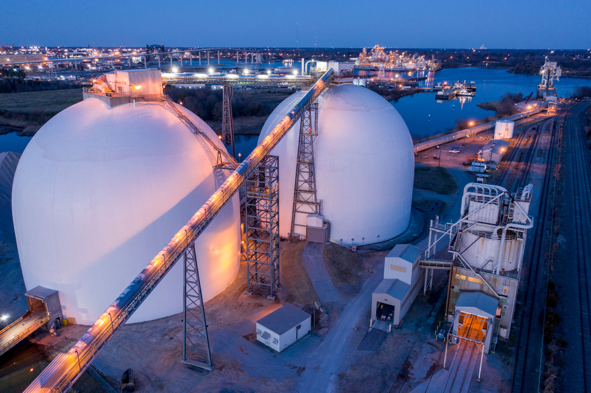 Large spherical domes of the Enviva wood pellet export shipping terminal on the Elizabeth River in Norfolk Virginia