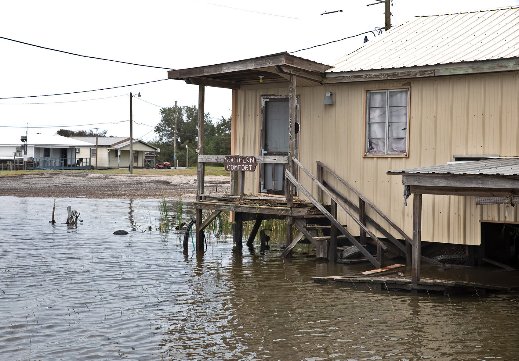 Floodwaters surround a fishing camp next to the boat launch on the Isle de Jean Charles, Louisiana.