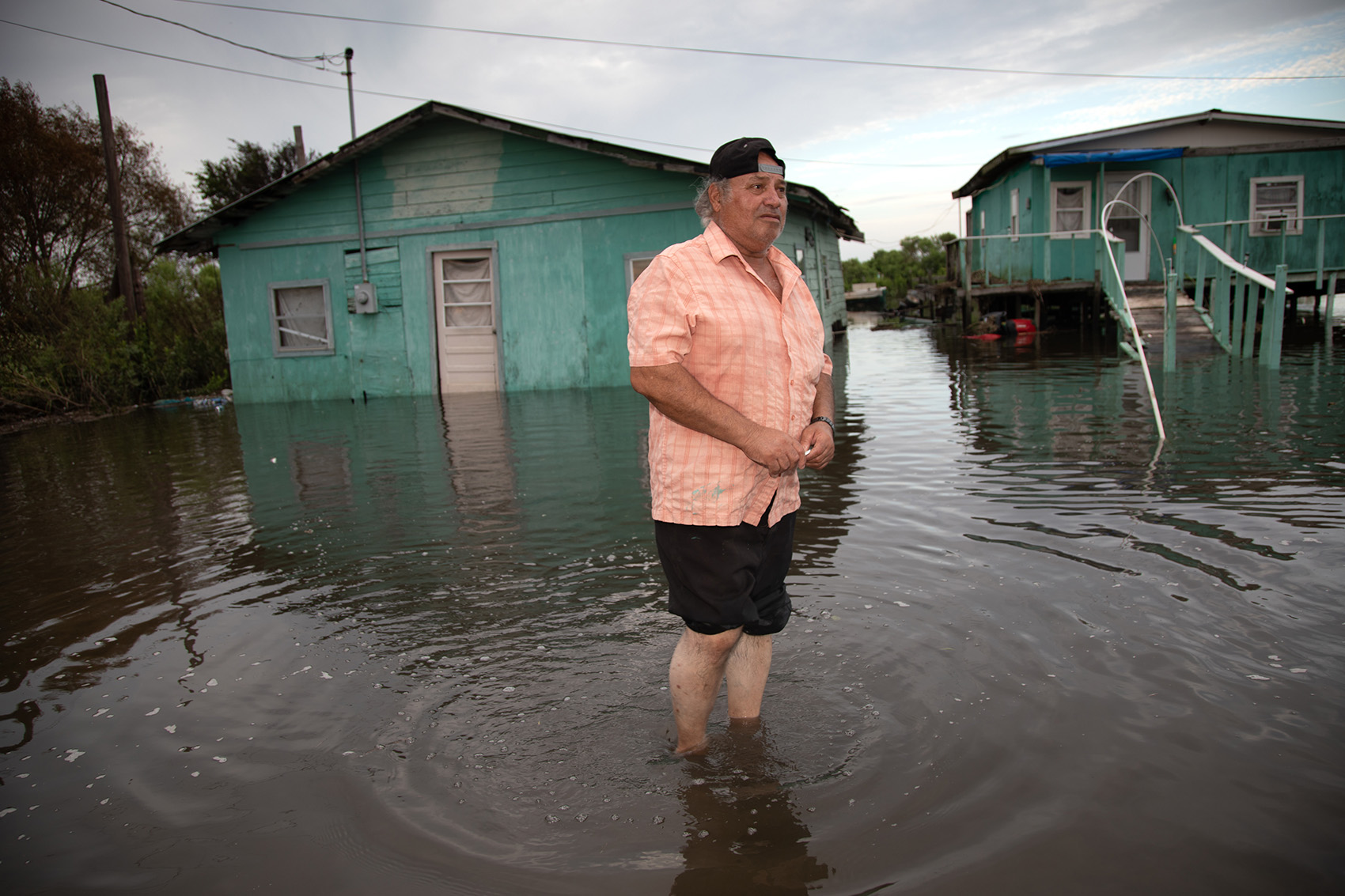 Hilton Chaisson returns to the Isle de Jean Charles to check on his flooded home.