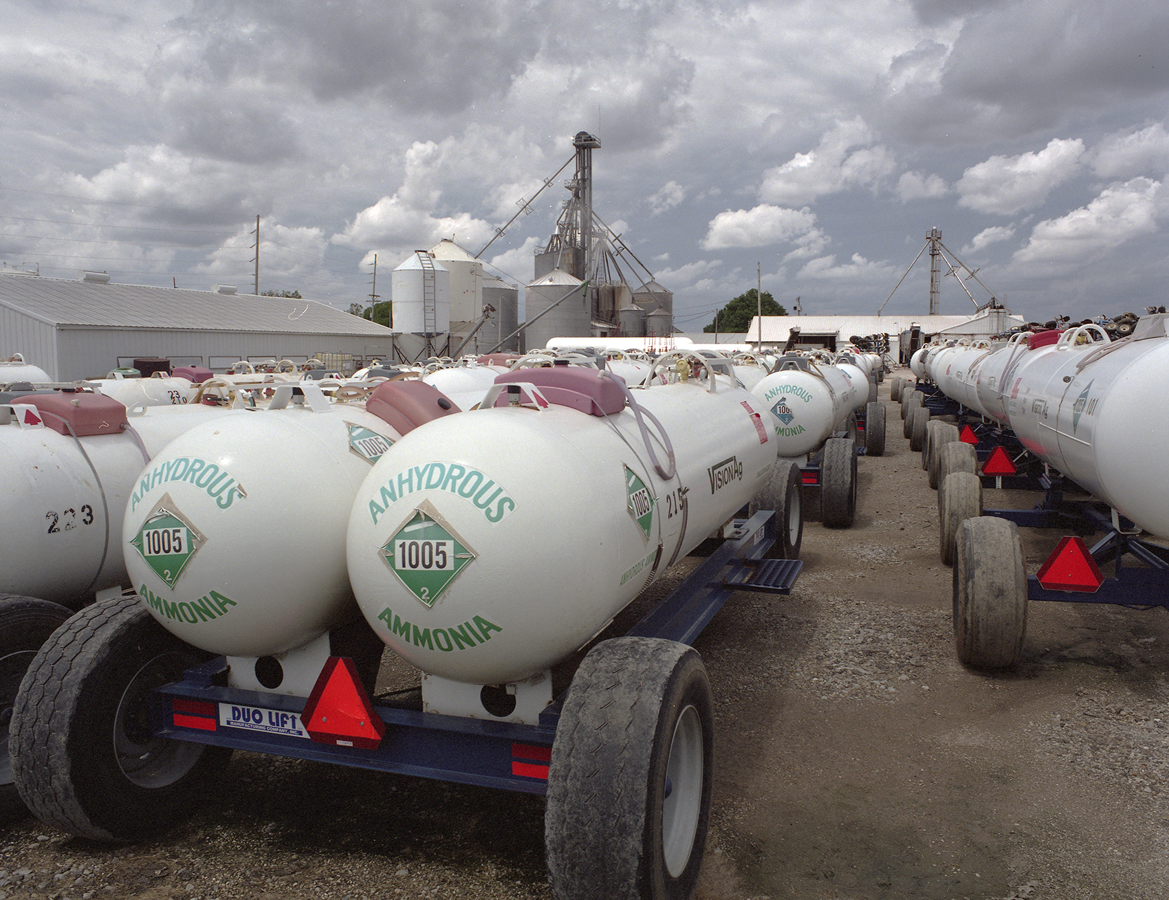 Fertilizer trucks are parked at Vision Agriculture. Alongside the Hypoxia Task Force's promise to shrink the dead zone by 20 percent, Iowa's Nutrient Reduction Strategy have also promised to make a 45 percent decrease in fertilizer runoff.