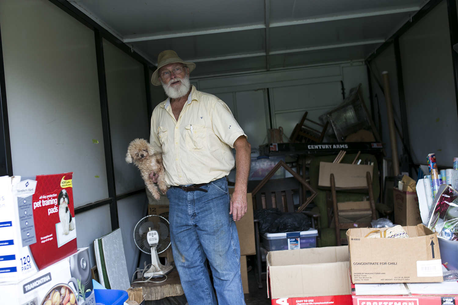 Robert Daffin stores his belongings inside a storage unit parked in front of his home in Marianna, Fla., while he repairs his house after the storm.
