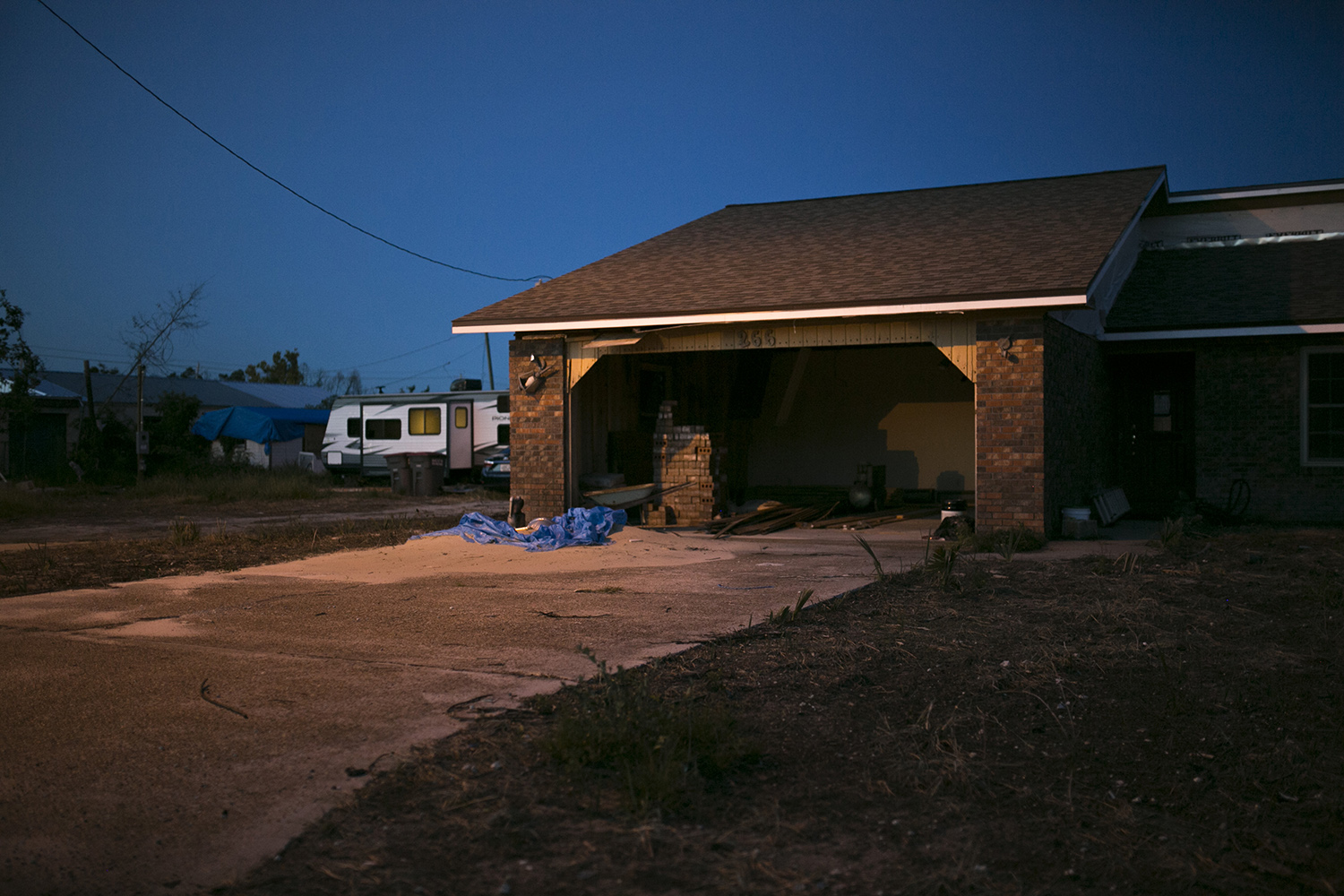 A house in Panama City, Fla., is seen nine months after Hurricane Michael. Many residents still live partly out of trailers in their yards and partly in their ravaged homes.