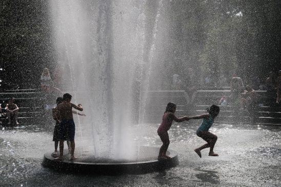 People try and stay cool in the fountain in Washington Square Park during the start of heat wave across the U.S.(Spencer Platt/Getty Images)