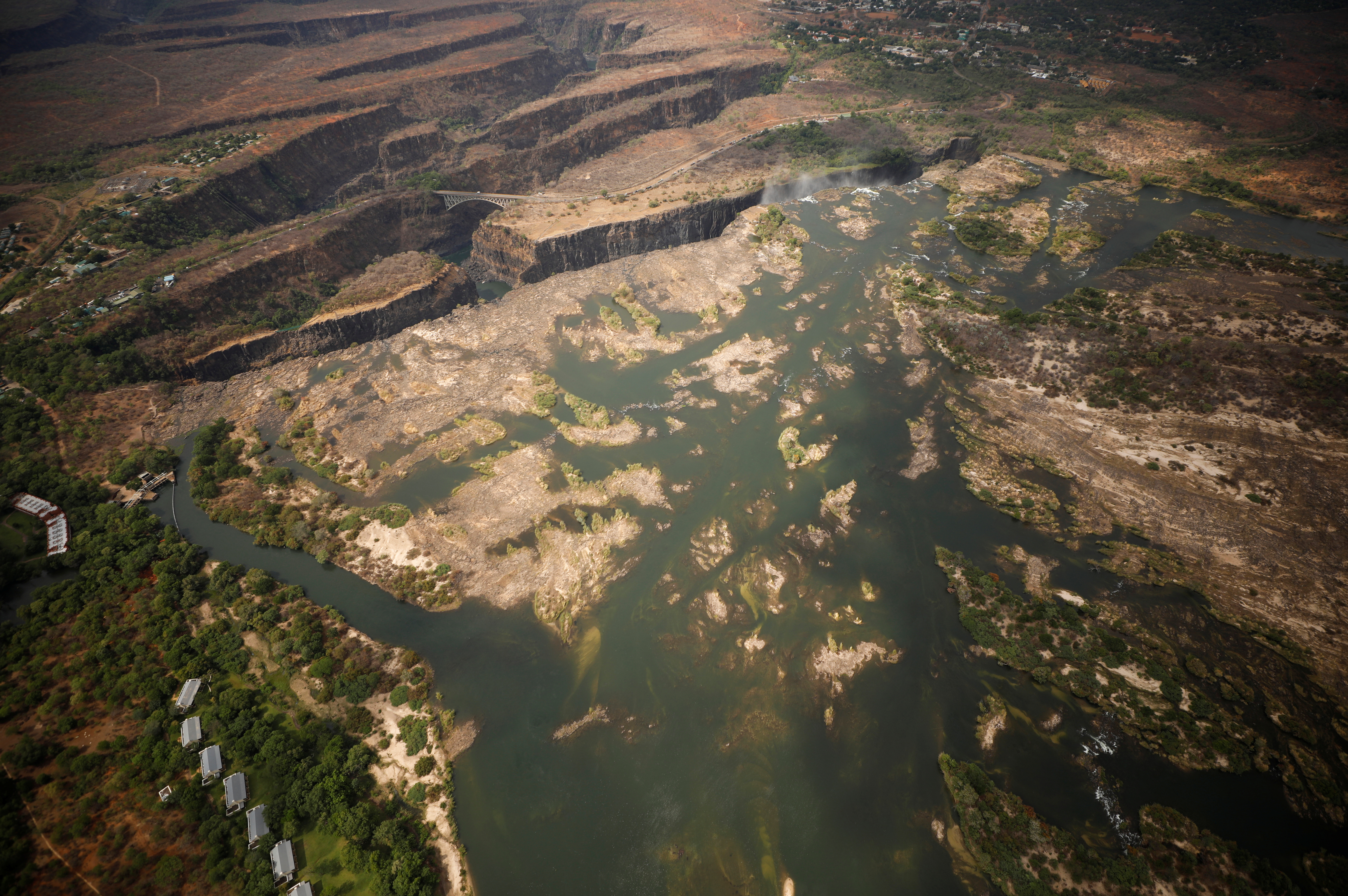 A dry section of the Zambezi river is seen above the gorge on the Zambian side of Victoria Falls, Zambia, following a prolonged drought, Dec. 5, 2019.