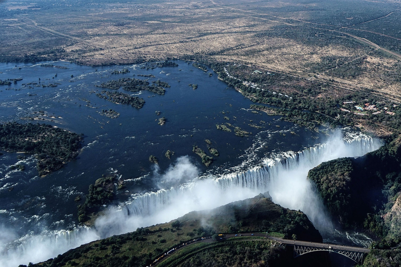 An aerial view taken on June 29, 2018, shows the site of the Victoria Falls as it usually appears, gushing with water.