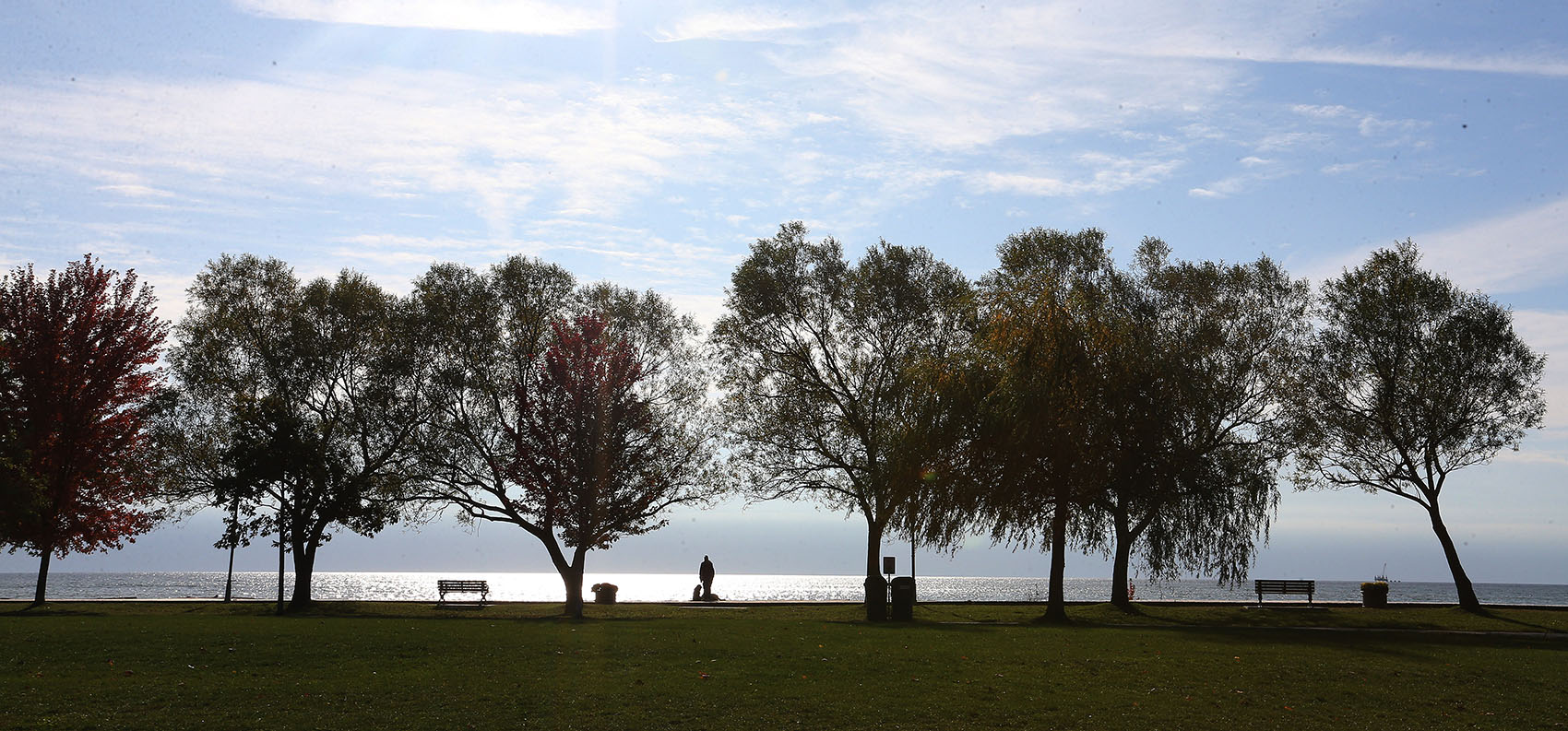 A person pauses from their walk on the boardwalk to look out on Lake Ontario at the Beaches in Toronto on Oct. 24, 2019. (Steve Russell/Toronto Star via Getty Images)