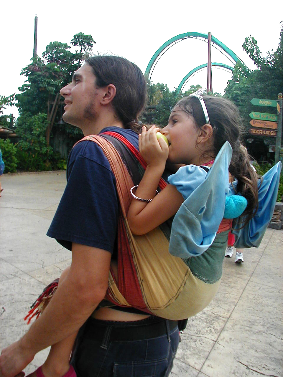 4 year old has a snack at Busch Gardens: rucksack in Mary EllaRoo