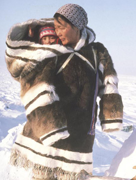 Inuit mother with traditional Amauti baby carrier, Greenland