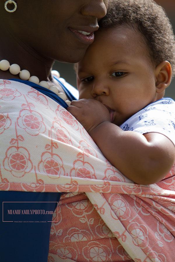 Cute baby in cute Clementine flower wrap