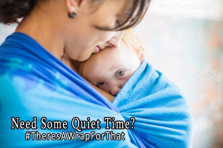 Overstimulated toddler cuddles against mom in Natibaby wrap.
