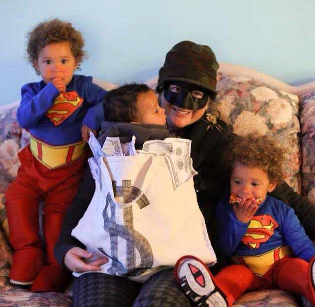 Mama Burglar, baby money sack, and twin superhero babywearing costume