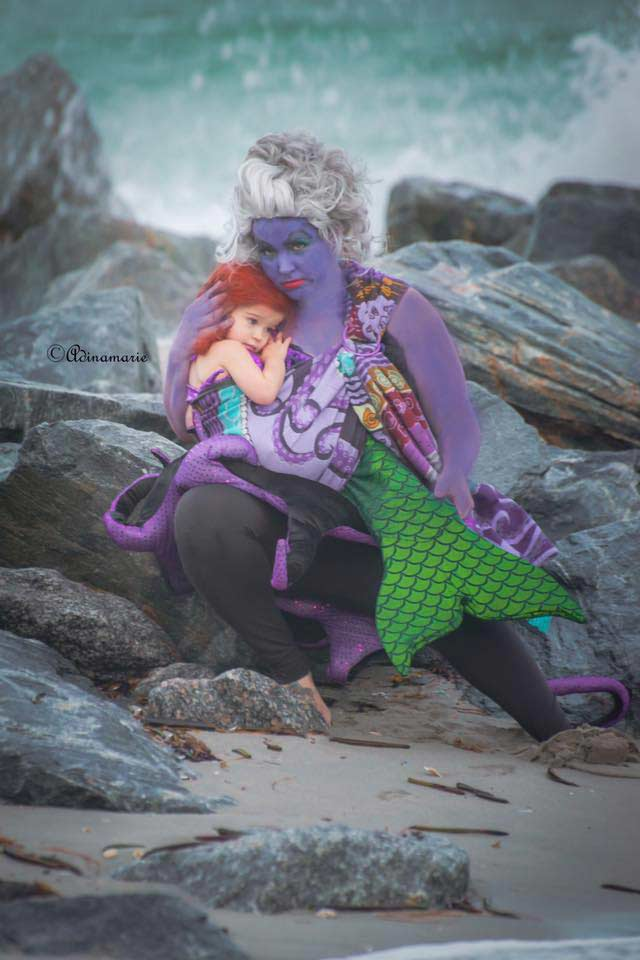 Ursula the Sea Witch has little Ariel all wrapped up in this Little Mermaid babywearing costume