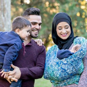 Happy Muslim family in Wrapsody Anna baby wrap
