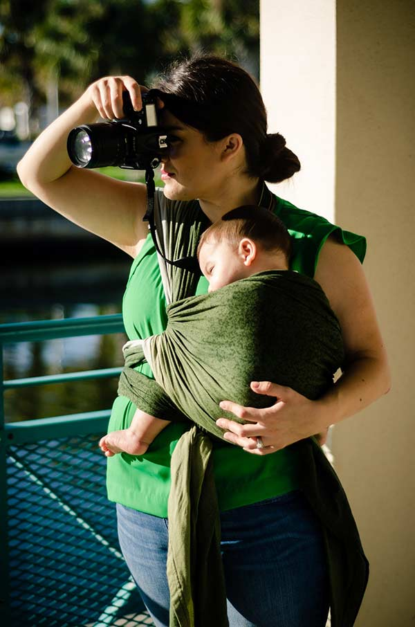 Photog mom with baby in Wrapsody Oliver wrap