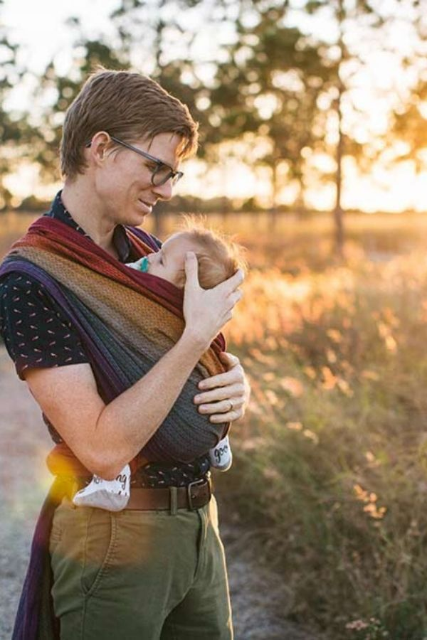 Dad wrapped in Girasol Rainbow Love woven wrap
