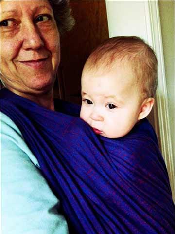 Grandbaby wrapped on Grandmother