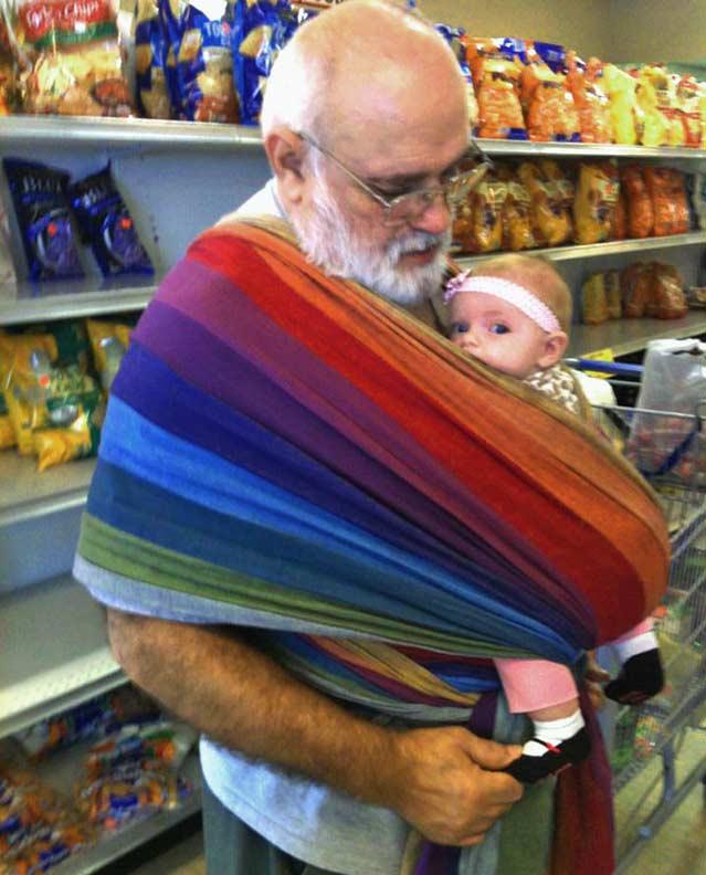 Grandbaby wrapped on Babywearing Grandfather