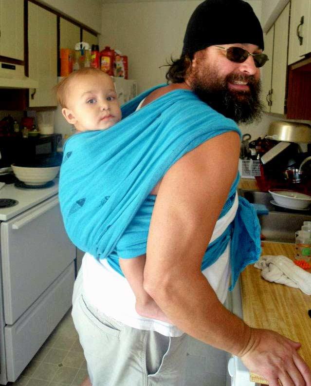 Grandbaby wrapped on Grandpa's Back