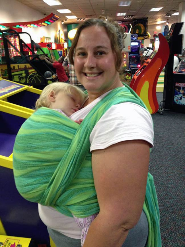 Heidi wears size 16/18 and is using a size 6 wrap in a FWCC with her 15 month old toddler.
