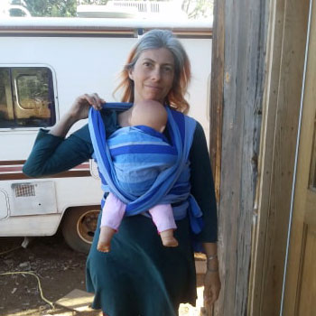 Pull the wrap away from your neck for comfy babywearing.