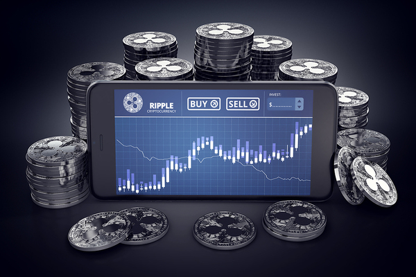 Piles of ripple silver coins surrounding a mobile phone with a chart.