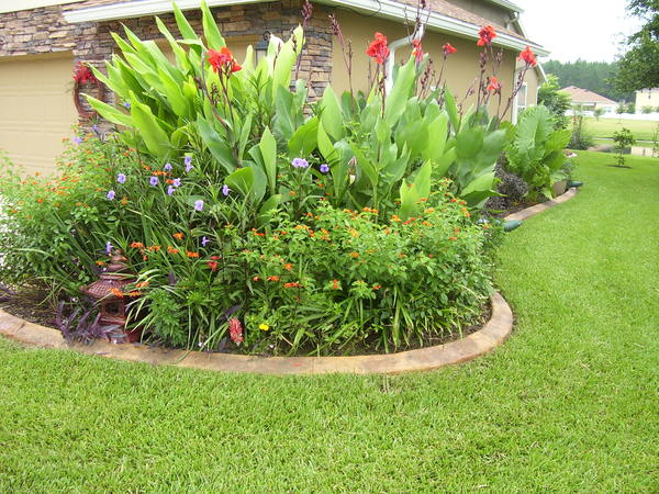 Granite look concrete edging enhances the beauty of this homes landscaping