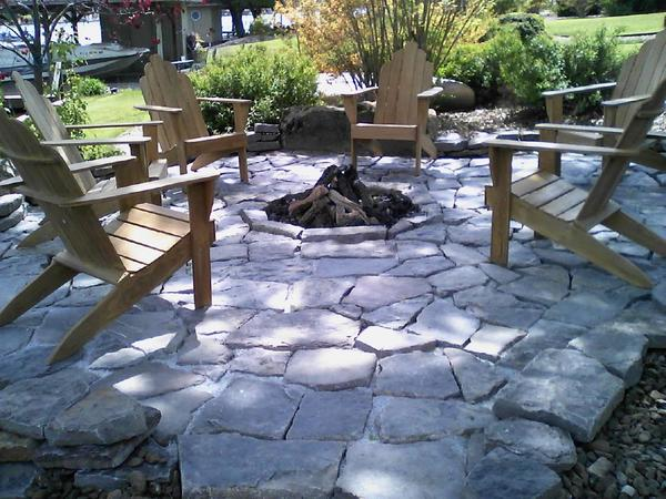 Fire pit and custom rock sitting area
