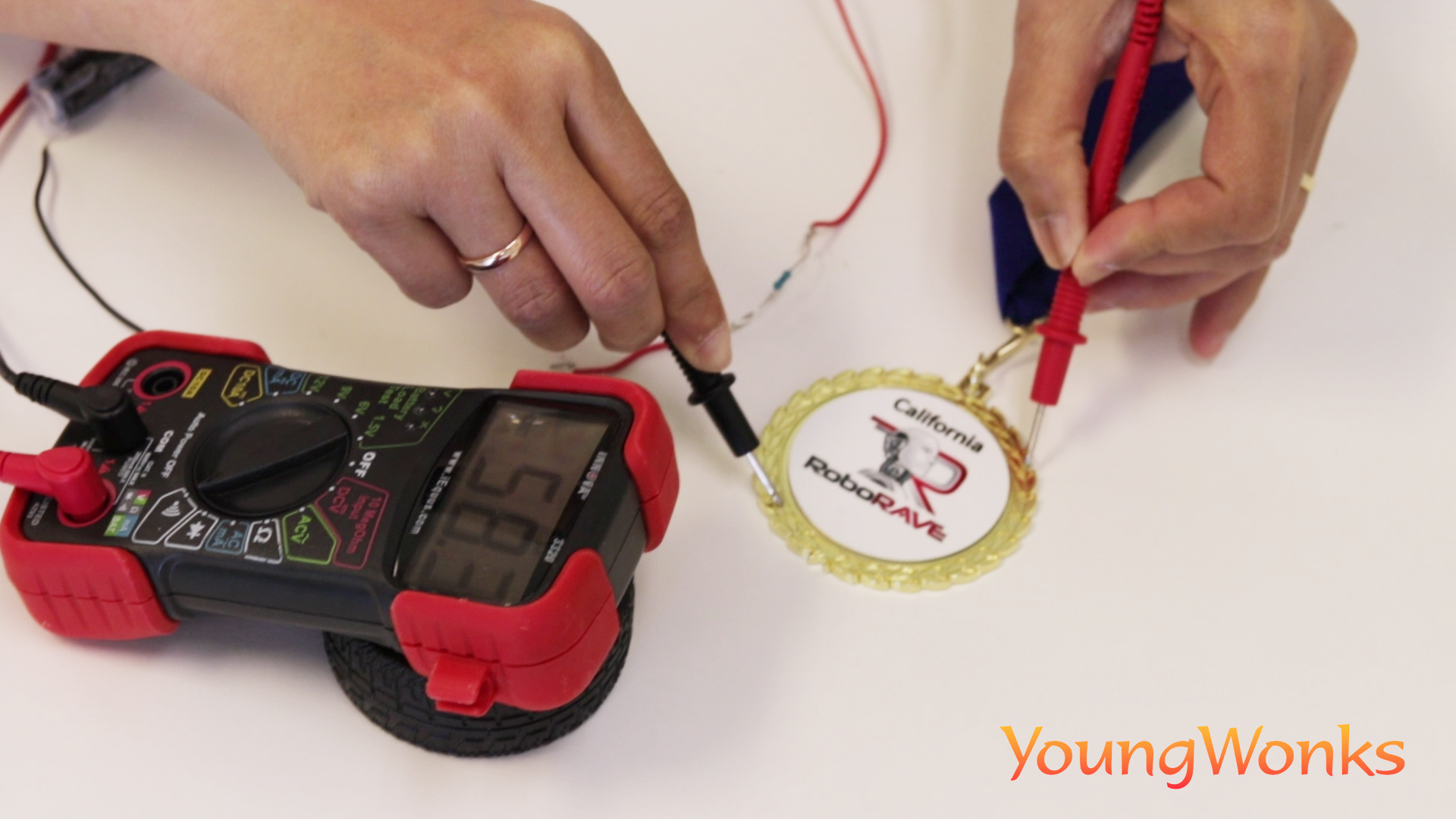 Checking for conductivity between points of a medal