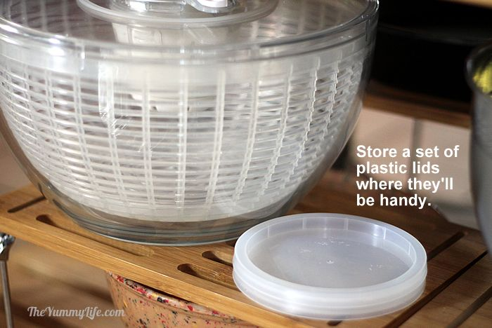 Salad spinner and plastic lids.