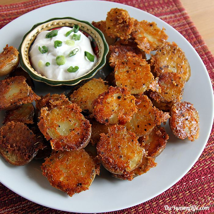 Easy, Crispy, Parmesan Garlic Roasted Baby Potatoes have amazing flavor and texture. They can be prepared quickly for a healthy dinner side, Game Day or party snack, or breakfast and brunch potatoes. TheYummyLife.com#crispypotatoes #vegetarian #glutenfree #parmesanpotatoes #easyrecipe #potatorecipes #theyummylife